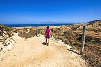 Hiker at Water Canyon, Santa Rosa Island, Channel Islands National Park, California USA.