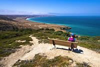 Hiker enjoying the view from the Torrey Pines Trail, Santa Rosa Island, Channel Islands National Park, California USA.