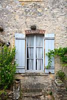 old window with wooden shutters in Bourgogne, France