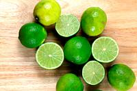 Limes on wooden board