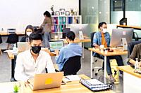 Group of interracial business worker team wear protective face mask in new normal office with social distance practice with hand sanitiser alcohol gel...