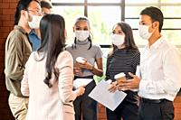 Group of business worker team meeting and brainstorm for startup new business. They wear protective face mask in new normal office preventing coronavi...