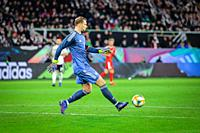 Wolfsburg, Germany, March 20, 2019: German goalkeeper Manuel Neuer kicks the ball during the international friendly game between Germany and Serbia at...