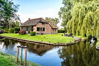 Giethoorn, Netherlands - August 5, 2016: The village Giethoorn is unique in the Netherlands because of its bridges, waterways and typical boats calle ...