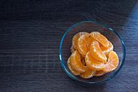 Glass bowl with orange segments.
