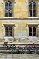 Bicycles parked along the pavement in centre of Cambridge, England, UK.