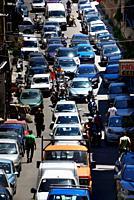 Narrow, full of cars street Via Generale Cadorna Luigi near Norman Palace (Royal Palace, Palazzo Dei Normanni, Palazzo Reale), high traffic in histori...