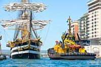 "22 August 2020 - Tug Boat """"Dritto"""" assist the mooring of the tall ship â. œAMERIGO VESPUCCIâ. . on the dock of Aragonese Castle of Taranto, Italy; T..."