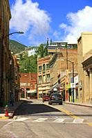 Main street in Old Bisbee surrounded by the Mule Mountains in SE Arizona.