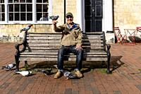 A Local Man Feeding The Pigeons, High Street, Lewes, East Sussex, UK.
