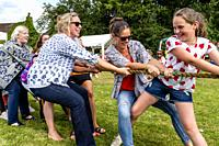 Females Take Part In A Tug Of War, Fairwarp Fete, Fairwarp Village, East Sussex, UK.