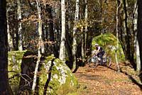 France, Tarn, Sidobre region, Mountain biking in the forest.