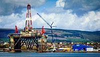 Oil rig at the iFab Fabrication facility at Invergordon on the Cromarty Firth dwarf houses in the village.