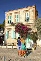 Couple in front of the traditional house at Smaller Sea-Küçükdeniz district of Old Foca, the ancient Phokaia, Foca, Izmir, Aegean Region, Turkey, Euro...