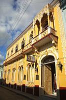 Colonial building with balconies in the city center, Santiago De Cuba, Cuba, Central America.