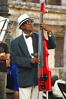 Acoustic bass player during a performance on a celebration day at Paseo Del Prado in Center Havana, La Habana, Cuba, Central America.