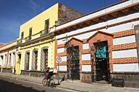 Cyclist in front of the colonial buildings at the historic center, Puebla, Puebla State, Mexico, Central America.