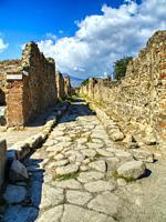 cobblestone street at Pompeii, Italy.