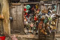 Travel to Zanzibar. Shop full of second-hand products. The owner apparently knows exactly what's inside!.