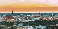 Riga, Latvia. Top View Panorama Skyline Cityscape At Sunset Light. St. Peter's Church, Boulevard Of Freedom, National Library, Dome Cathedral, Basilic...