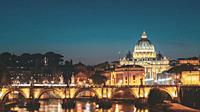 Rome, Italy. Papal Basilica Of St. Peter In The Vatican And Aelian Bridge In Evening Night Illuminations.
