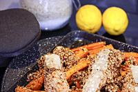 Grilled salmon with sesame seeds and carrots.