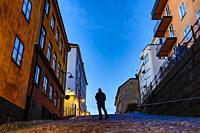 Stockholm, Sweden A man walking on the historic Bellmansgatan in the early morning.