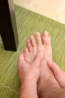 Finger man toe injured after kicking a table foot.
