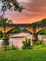 Dordogne Bridge at Rouffillac at sunset, near Carlux, Dordogne Department, Nouvelle Aquitaine, France.