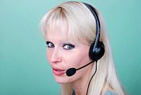 Portrait of young woman with headset.