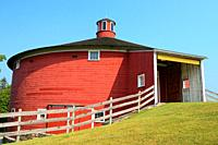 The round barn serves as a landmark and entrance to the Shelburne Museum in Vermont.