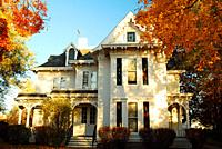 The home of President Harry S Truman in Independence, Missouri is surrounded by autumn foliage.