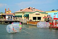 People take to inflatable tubes and roll onto a lake in Myrtle Beach, South Carolina.