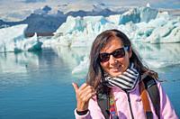 Woman smiling visiting Jokulsarlon Glacier Lagoon in summer, Iceland.