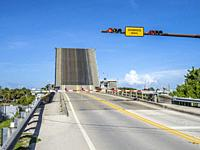 Lift Bridge over Gulf Intercastal Waterway in raised up position in Venice Florida.