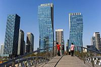 Seoul, South Korea, Asia - People on a bridge in front of the cityscape of New Songdo City in Central Park and the international business district (SI...