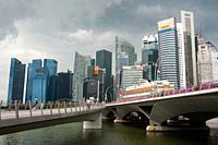Singapore, Republic of Singapore, Asia - Cityscape with dark thundery clouds over the skyline and the skyscrapers of the central business district at ...