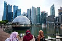 Singapore, Republic of Singapore, Asia - View of the new Apple Flagship Store along the waterfront at Marina Bay Sands with the city skyline of the ce...