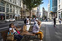people with face mask in gran via street. madrid. spain.