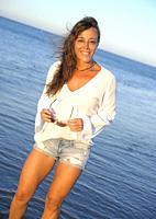 young girl enjoying comfortable morning clothes on the Islantilla beach, Huelva