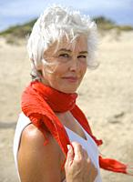 Mature woman in a white suit enjoying an afternoon on the Islantilla beach, Huelva