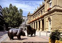 Bull and bear statues stand outside the Frankfurt Stock Exchange in Frankfurt, Germany. The Frankfurt Stock Exchange (German: Frankfurter Wertpapierbö...