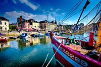 A yacht in the harbour in Honfleur, France.