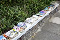 Books left on wall in Batteresea for public to take and read, London UK.