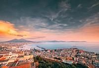 Naples, Italy. Top View Skyline Cityscape City In Evening Sunset. Tyrrhenian Sea And Landscape With Volcano Mount Vesuvius.