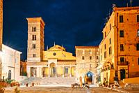 Terracina, Italy. Tower Of Cathedral Of San Cesareo In Night Time. It Built On Podium Of Temple Of Roma And Augustus.