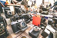 Tbilisi, Georgia. Shop Flea Market Of Antiques Old Retro Vintage Things On Dry Bridge In Tbilisi. Different Vintage Old Retro Cameras On Ground.