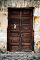 Old Weathered Wooden Door of Historic Spanish Colonial Home.