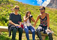 Three generations female on a mountain excursion.
