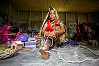 """Bangladesh â. """" May 13, 2018: An old woman is making a rope from the fibers of a banana tree with the help of her feet in an ancient way at Madhupur, ..."""